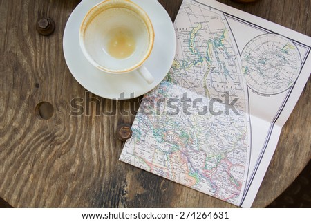 Empty coffee cup and the old map, Europe and travel - top view - stock photo