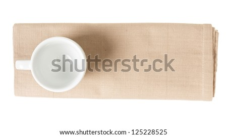 empty coffee cup on napkin from above, isolated - stock photo