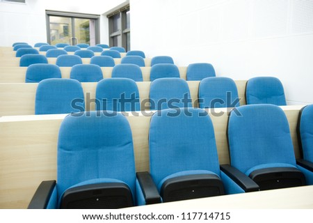 Empty college lecture hall in university - stock photo