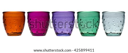 Empty colorful glasses isolated on a white.
