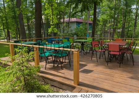 empty colorful tables at an outdoor cafe