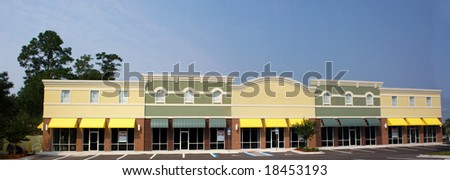 empty commercial strip mall ready for retail shops - stock photo