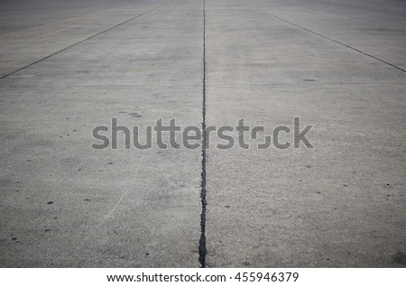 empty concrete road with dark edges