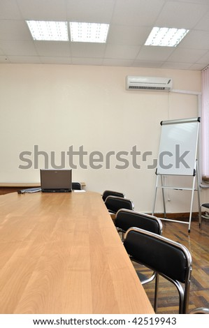 Empty conference hall with board - stock photo