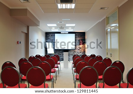 Empty conference room ready for audience - stock photo