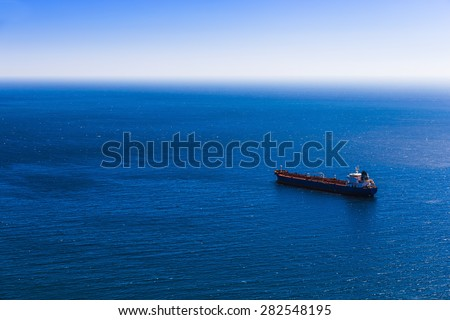 Empty container cargo ship in the blue sea. Aerial view - stock photo