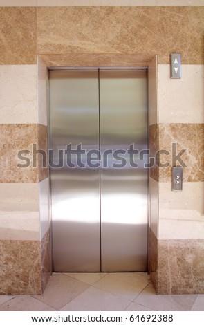 empty contemporary interior with elevator steel doors - stock photo