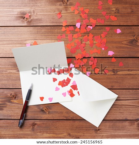 Empty copyspace valentine card or love letter composition over the wooden boards covered surface - stock photo