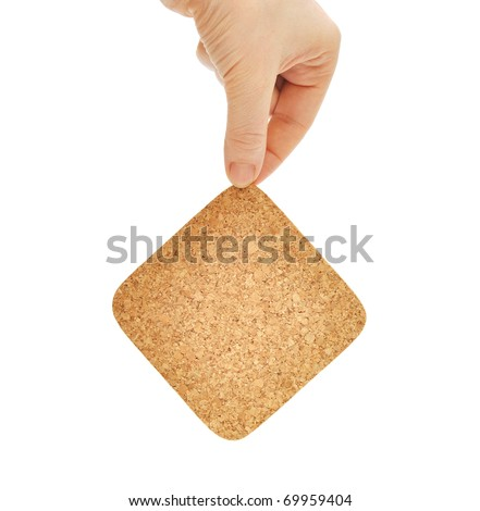 Empty cork in the hand isolated white background
