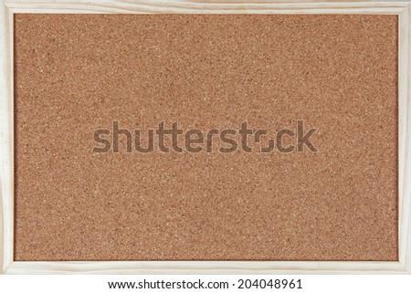 Empty corkboard / bulletin board with a wooden frame - stock photo