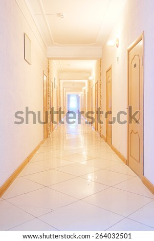 Empty corridor in a hotel - stock photo