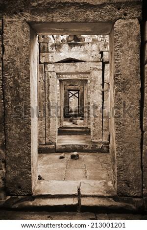 Empty Corridor Ruin in Sepia - stock photo