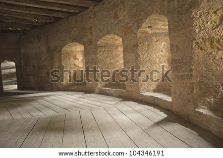 empty corridors on ancient building in europe. - stock photo