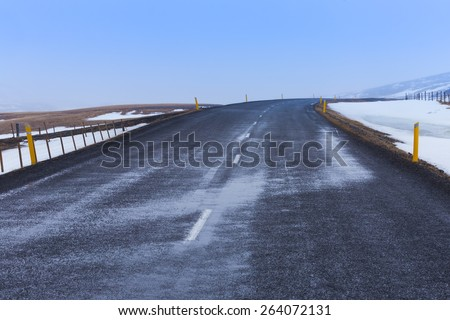 Empty country road in winter day, Iceland - stock photo