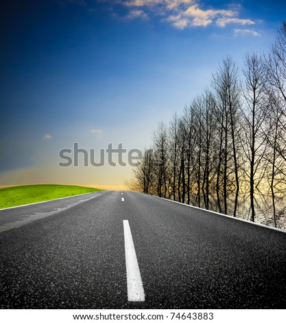 Empty countryside road - stock photo