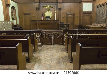 Empty courtroom with judge chair - stock photo