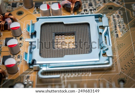 Empty CPU processor socket with pins on motherboard - stock photo