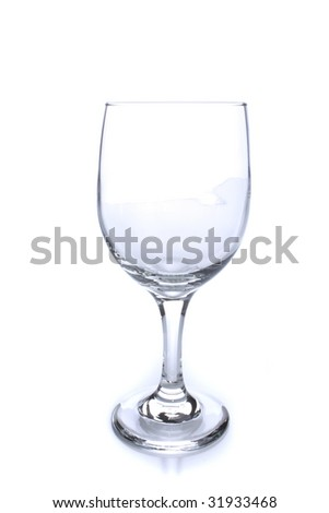 Empty crystal wine glass with light reflection