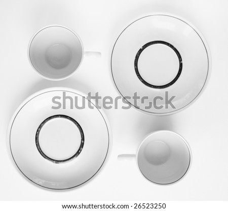 empty cup and saucer on light background