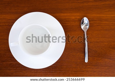 Empty cup of coffee with teaspoon - stock photo