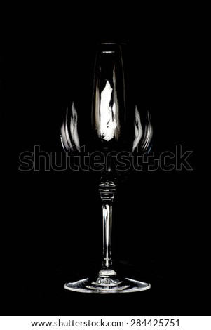 Empty cup of glass on black background - stock photo