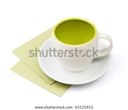 Empty cup on green placemat. Isolated on white background - stock photo