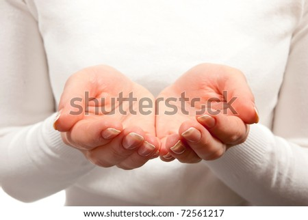 Empty cupped woman hands on white background - stock photo