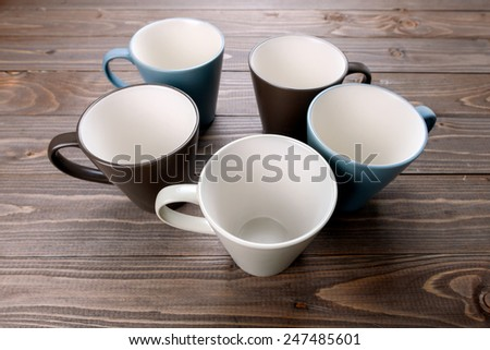 empty cups on wood background - stock photo