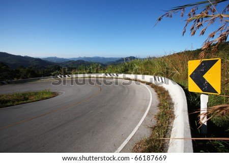 empty curve highway on mountain. - stock photo