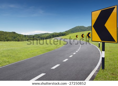 empty curve road with turning left sign - stock photo