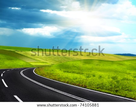 Empty curved road - stock photo
