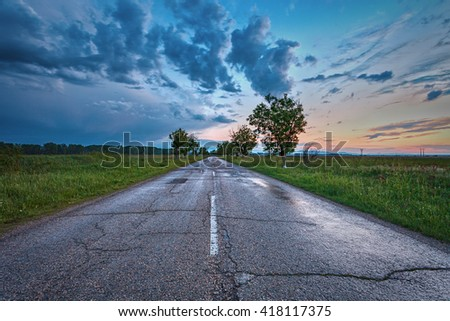 Empty curved road,blue sky and sunset.  - stock photo