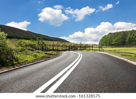 Empty curved road,Yorkshire,uk - stock photo