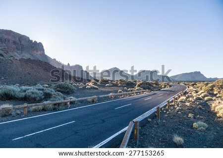 Empty curvy desert road to volcano Teide, Tenerife, Spain - stock photo