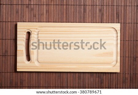 Empty  cutting board on wooden  background  - stock photo