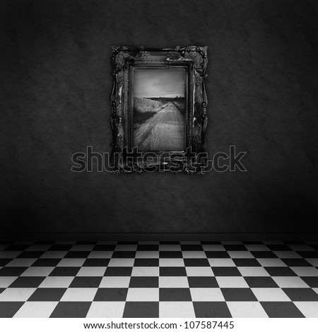 Empty, dark, psychedelic room with black and white checker on the floor and a painting symbolizing hope, on the dark wall - stock photo