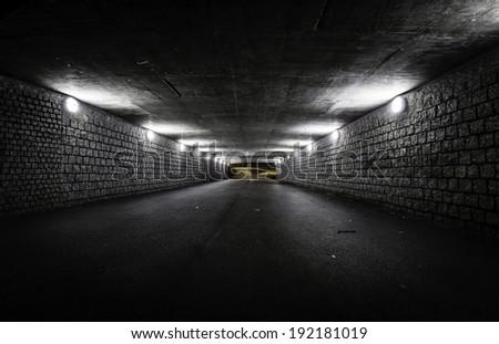 Empty dark tunnel at night - stock photo