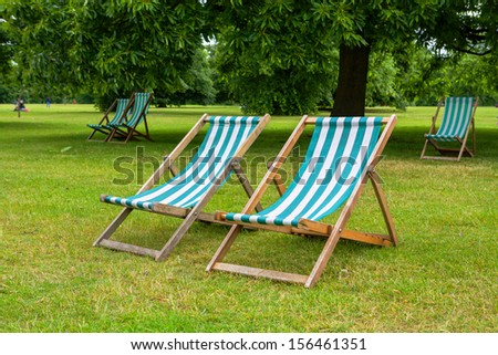 Empty deckchairs in Hyde Park. London, England - stock photo