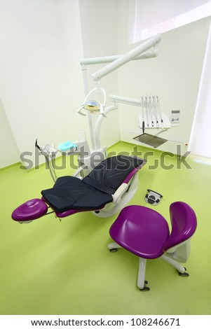 Empty dental clinic. Big and comfortable chair for patient, chair and drill for dentist.