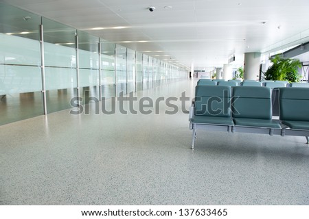Empty departure lounge at the airport - stock photo