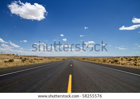Empty desert road stretching in New Mexico USA - stock photo
