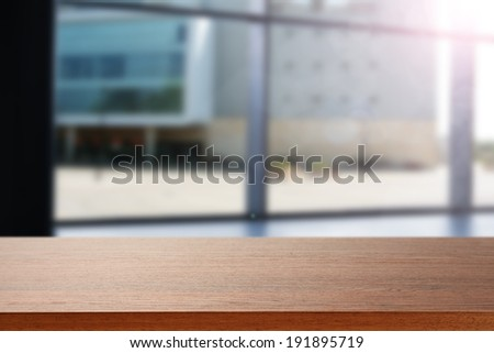 empty desk and blue window  - stock photo