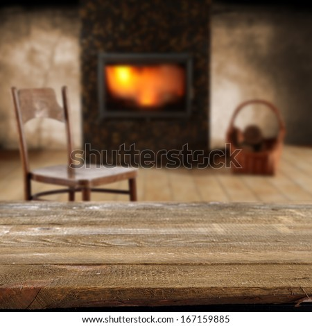 empty desk chair and fireplace  - stock photo