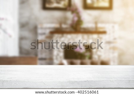 Empty desk platform with fireplace and reception room background. For product display montage. - stock photo