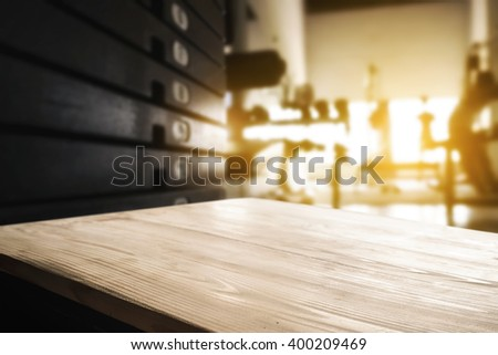 Empty desk space platform and fitness gym background with weight stack. For product display montage. - stock photo