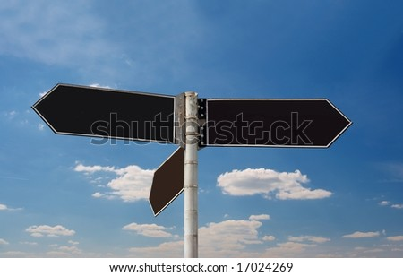 Empty direction sign boards against blue sky
