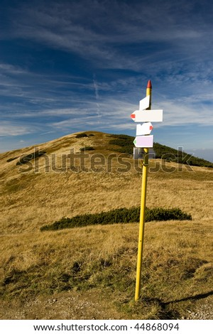 Empty direction signs in the mountains - stock photo