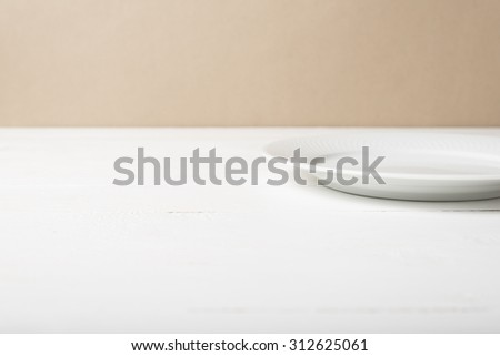 empty dish over white table background