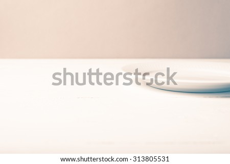 empty dish over white table background vintage style