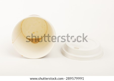 Empty disposable paper cup for coffee isolated on the white background - stock photo